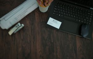 Wood Desk with Laptop and MK Property Services Business Card